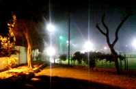 The green corner of the Gandhi stadium glittering under the flood lights.